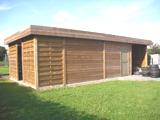 Moderne carport met tuinhuis houtberging